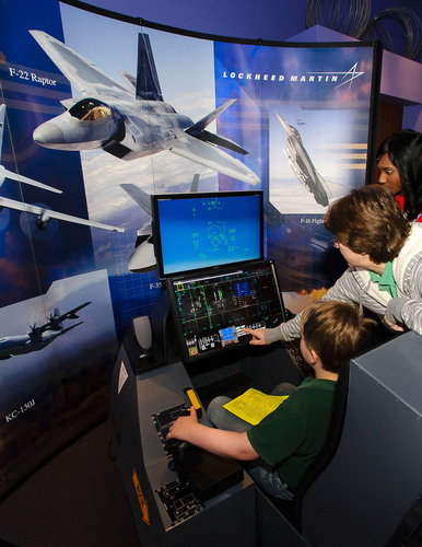 """Lockheed Martin Aeronautics employees in Fort Worth, Texas, help local students """"fly"""" the F-35 at the ..."""
