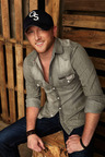 "Muve First artist Cole Swindell is earning music industry accolades with the track ""Chillin' it"" that hit number one on Billboard's Top Country Songs chart. Swindell, whose self-titled debut album is available now on Muve Music, offers fans a bonus in-studio recording, where he talks about his have-fun high-energy philosophy and how he got over a past relationship. To stay on top of Muve Music from Cricket and its featured artists, follow the #MuveMusic hashtag.  (PRNewsFoto/Cricket Communications, Inc.)"