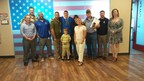 Wounded Warrior Project (WWP) Chadwick James poses with staff, during his cross country adventure to raise awareness and support for WWP.