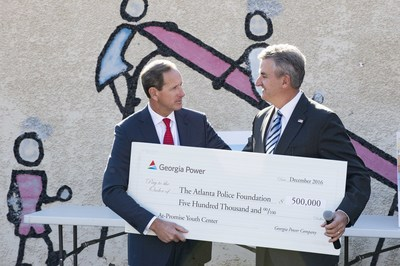 Paul Bowers, chairman, president and CEO of Georgia Power presents a check to Dave Wilkinson, President and CEO, Atlanta Police Foundation.