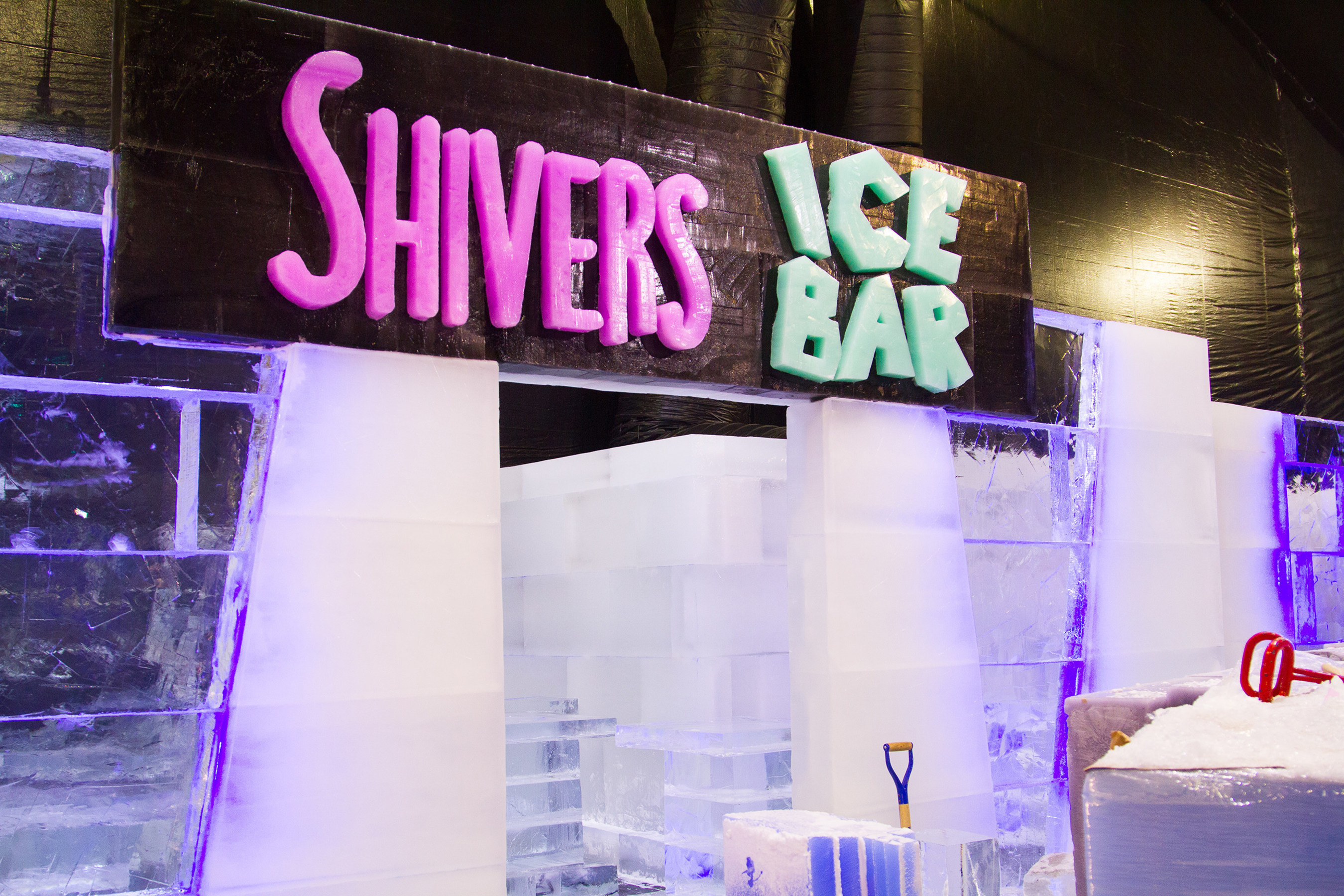 """Moody Gardens revealed Shivers Ice Bar, a fully functional bar made completely if ice as a new feature for the ICE LAND: Ice Sculptures, A Caribbean Christmas"""" attraction scheduled to open November 12 in Galveston, TX."""