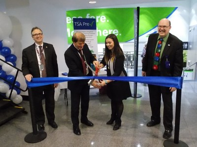 Representatives from Cleveland Hopkins International Airport and Vacation Express celebrate the new flights with a ribbon cutting ceremony.