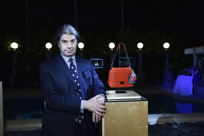 John Armleder and his handbag at the Yara Bashoor cocktail in Miami