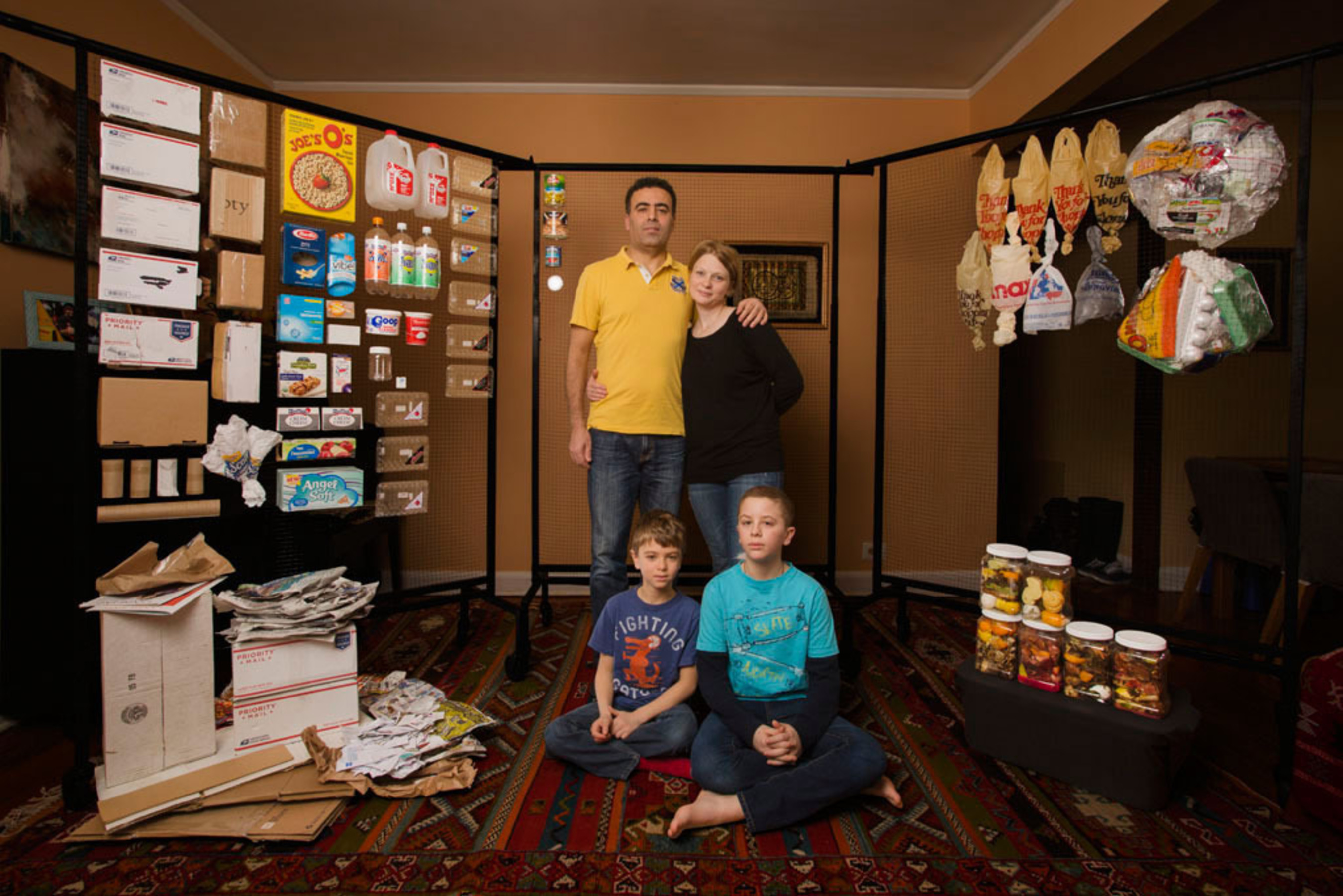 Yuliya Radchenko and Walid Halabi of NYC, New York, with their children Zacharia, 7, and Khalid, 11, surrounded by a week's worth of their recyclables and landfill trash, in February. Recyclable items are on the left-hand side of the photo. Items destined for landfill are to the right. Their total household waste for this week was 21 lb. Fifty-two percent of it (10.9 lb) was landfill and forty-eight percent of it was recyclables (10.1 lb).  (PRNewsFoto/The GLAD Products Company)