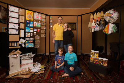 Yuliya Radchenko and Walid Halabi of NYC, New York, with their children Zacharia, 7, and Khalid, 11, surrounded by a week's worth of their recyclables and landfill trash, in February. Recyclable items are on the left-hand side of the photo. Items destined for landfill are to the right. Their total household waste for this week was 21 lb. Fifty-two percent of it (10.9 lb) was landfill and forty-eight percent of it was recyclables (10.1 lb). (PRNewsFoto/The GLAD Products Company) (PRNewsFoto/THE GLAD PRODUCTS COMPANY)