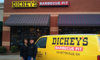 Owners Jeffery and Chung Kerkes in front of the new Dickey's Barbecue Pit in Fayetteville, GA.  (PRNewsFoto/Dickey's Barbecue Restaurants)