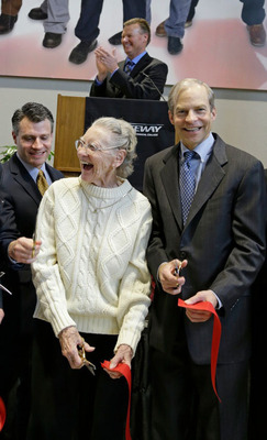Fisk Johnson, Chairman and CEO of SC Johnson, and Beverly Tarnowski join together in a ribbon cutting ceremony celebrating the grand opening of the SC Johnson iMET Center as Gateway Technical College President, Dr. Bryan Albrecht, looks on. This latest addition to the college was supported through contributions from both SC Johnson and the Tarnowski family and is part of the expanded SC Johnson iMet Center in Sturtevant, Wis. The 18,000-square-foot facility includes training in computer numerical control (CNC) machining, industrial robotics and more.  (PRNewsFoto/SC Johnson)
