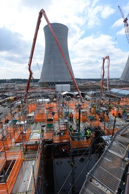 Workers complete the 45-hour continuous pour of 1,800+ cubic yards of concrete for the CA20 module at the Vogtle nuclear expansion on Sunday, March 6. The Unit 3 cooling tower is pictured in the background.