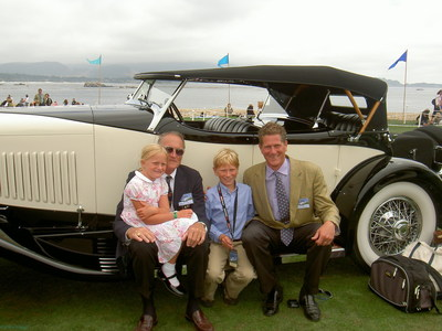 The Riegel family with their 1931 duPont Model H Sport Phaeton at the 2005 Pebble Beach Concours d'Elegance