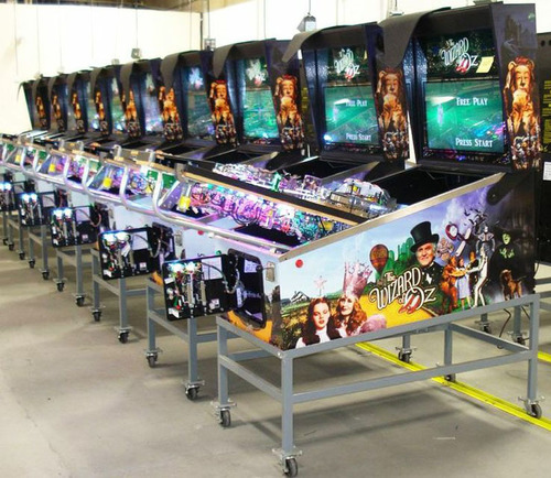 A batch of Wizard of Oz Pinball Machines make their way through the final testing phase of production.  ...