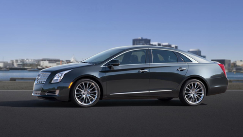 The Cadillac XTS full-size luxury sedan received a new twin-turbo V-6 engine to enhance its power capabilities for 2014.  (PRNewsFoto/Bill Jacobs Auto Group)