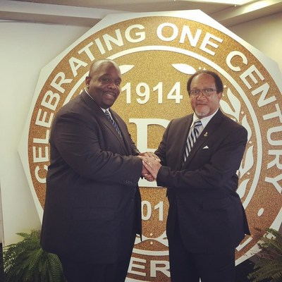 Shown in photo: Jonathan A. Mason, Sr. (left) and Dr. Benjamin Chavis (right). Mason shakes Dr. Chavis hands after presenting him with the keys for Phi Beta Sigma Fraternity, Inc. Headquarters, which will serve as the National Mobilization Headquarters for the 20th Anniversary of the Million Man March.