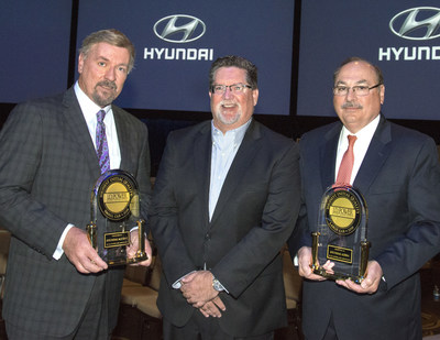 Hyundai CEO & President, Dave Zuchowski (left) and Executive Vice President of Customer Satisfaction, Frank Ferrara, flank Robert Mansfield, Sr. Director, Global Automotive at J.D. Power, with awards for Hyundai Azera as Highest Ranked Large Car in Initial Quality and Hyundai Accent as Highest Ranked Small Car in Initial Quality for 2016.
