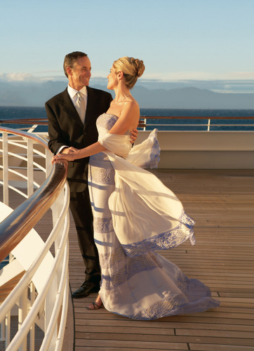 Crystal guests enjoy a private moment on the deck of Crystal Serenity.  (PRNewsFoto/Crystal Cruises)