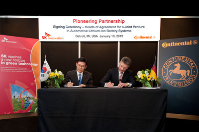 Dr. Jay Koo, CEO of SK Innovation (left) and Dr. Elmar Degenhart, CEO of Continental (right) commemorate the signing of a Heads of Agreement that describes the formation of a joint venture with which both companies want to develop, manufacture and market Lithium Ion battery systems for automotive applications. The signing was held today at the North American International Auto Show in Detroit. (PRNewsFoto/Continental)