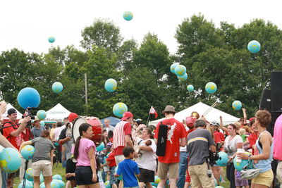 "Attendees of all ages joined in the fun as hundreds of globes cascaded into the crowd from the ""Maine Stage"" at the Celebrate Portland Festival on July 7 in honor of the International Year of The Cooperatives.  (PRNewsFoto/Cabot Creamery Cooperative)"