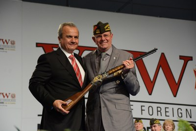 VFW Commander-in-Chief John W. Stroud being presented with a Henry Military Service Tribute Rifle by Anthony Imperato, President of Henry Repeating Arms at the VFW National Convention.