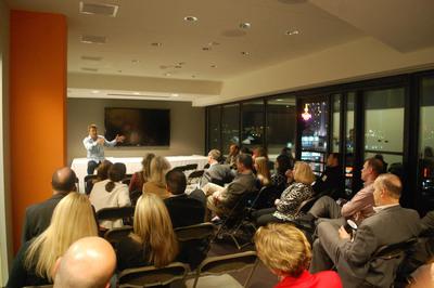 R2i CEO Matt Goddard addressing Loyola University MD Sellinger Business School Graduate Alumni.  (PRNewsFoto/R2integrated)