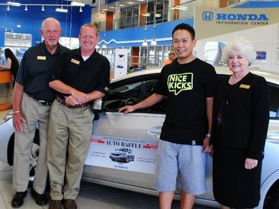 On June 27, 2014, the United Heritage Charity Foundation Auto Raffle winner, Michael Williams of Round Rock, Texas, was presented with a new 2014 Honda Civic LX by United Heritage Charity Foundation Chairman May Lofgreen, Howdy Honda General Sales Manager T.J. Nissen and Howdy Honda Customer Relations Director Jesse Lofgreen. (PRNewsFoto/Howdy Honda)