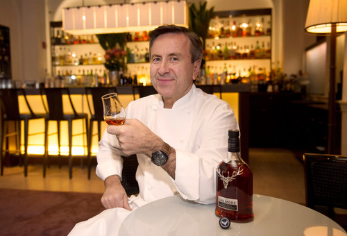 Chef Daniel Boulud with The Dalmore Selected by Daniel Boulud bottle and liquid. (PRNewsFoto/The Dalmore) (PRNewsFoto/THE DALMORE)