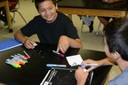 "7th Grade Noli Indian School students prepare their ""PongSat"" ping-pong balls for launch."