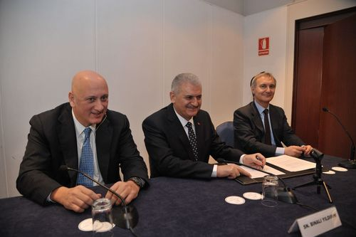 From left to right: Turkcell CEO Sureyya Ciliv; Turkey's Minister of Transport, Marina Affairs and ...
