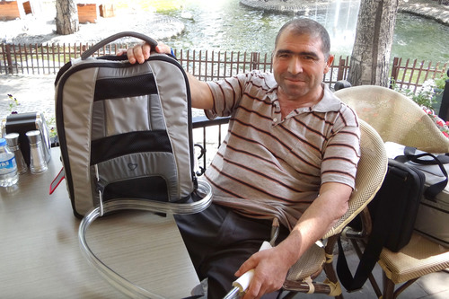 On July 10, 2012, Arif Sahin became the first SynCardia Total Artificial Heart patient to be discharged from Ankara University Heart Center in Turkey using the Freedom(R) portable driver, pictured in the Backpack. Mr. Sahin is currently waiting for a matching donor heart with his family in Ankara.  (PRNewsFoto/SynCardia Systems, Inc.)
