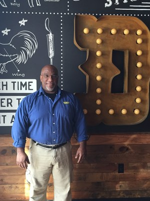 Owner/Operator Dr. Thomas (Doc) Driver celebrates the opening of his third Dickey's Barbecue Pit in Gig Harbor.