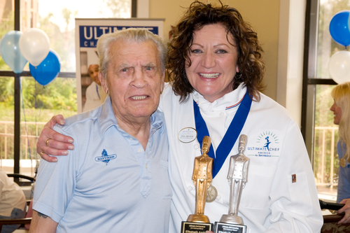 Chef Lisa Archer, newly-crowned Ultimate Chef America, celebrates with resident Marino D.  ...