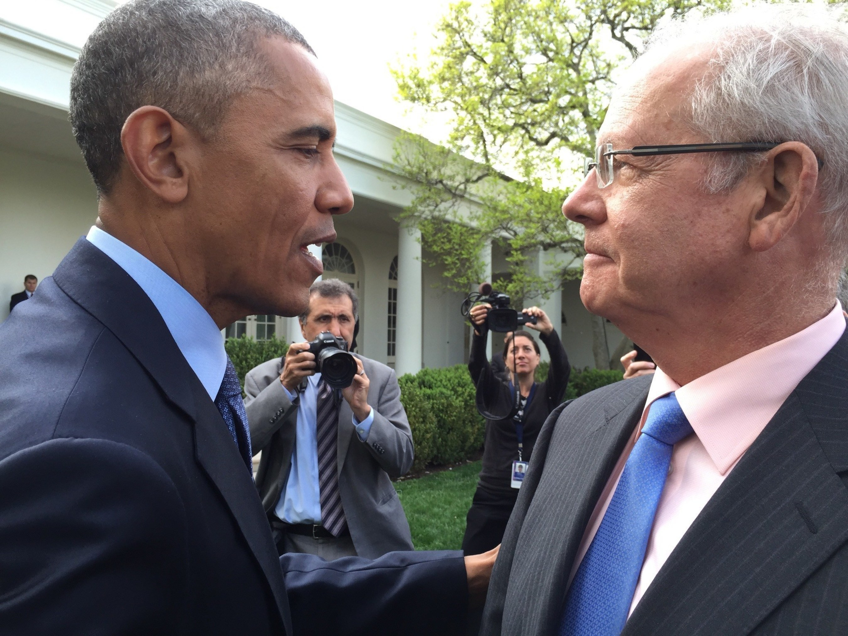 """President Barack Obama and David W. Parke II, M.D. (pictured right), CEO of the American Academy of Ophthalmology, at ceremony celebrating the enactment of the overwhelmingly bipartisan law reforming Medicare physician pay yesterday."""" (Photo credit: Saul Levin, M.D.)"""