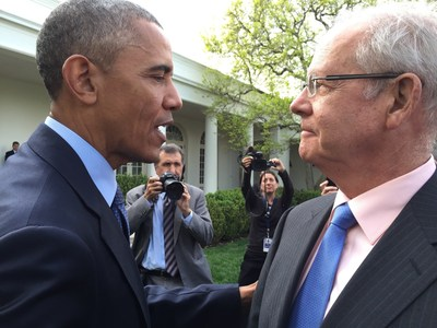 "President Barack Obama and David W. Parke II, M.D. (pictured right), CEO of the American Academy of Ophthalmology, at ceremony celebrating the enactment of the overwhelmingly bipartisan law reforming Medicare physician pay yesterday."" (Photo credit: Saul Levin, M.D.)"
