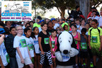 Snoopy greets children as they prepare to run a 1K at the Speech and Language Development Center's Coaster Run at Knott's Berry Farm.