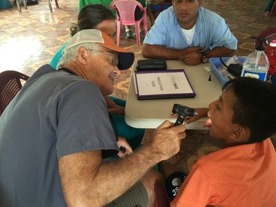Dr. Roy Blank evaluates a patient in Nicaragua.