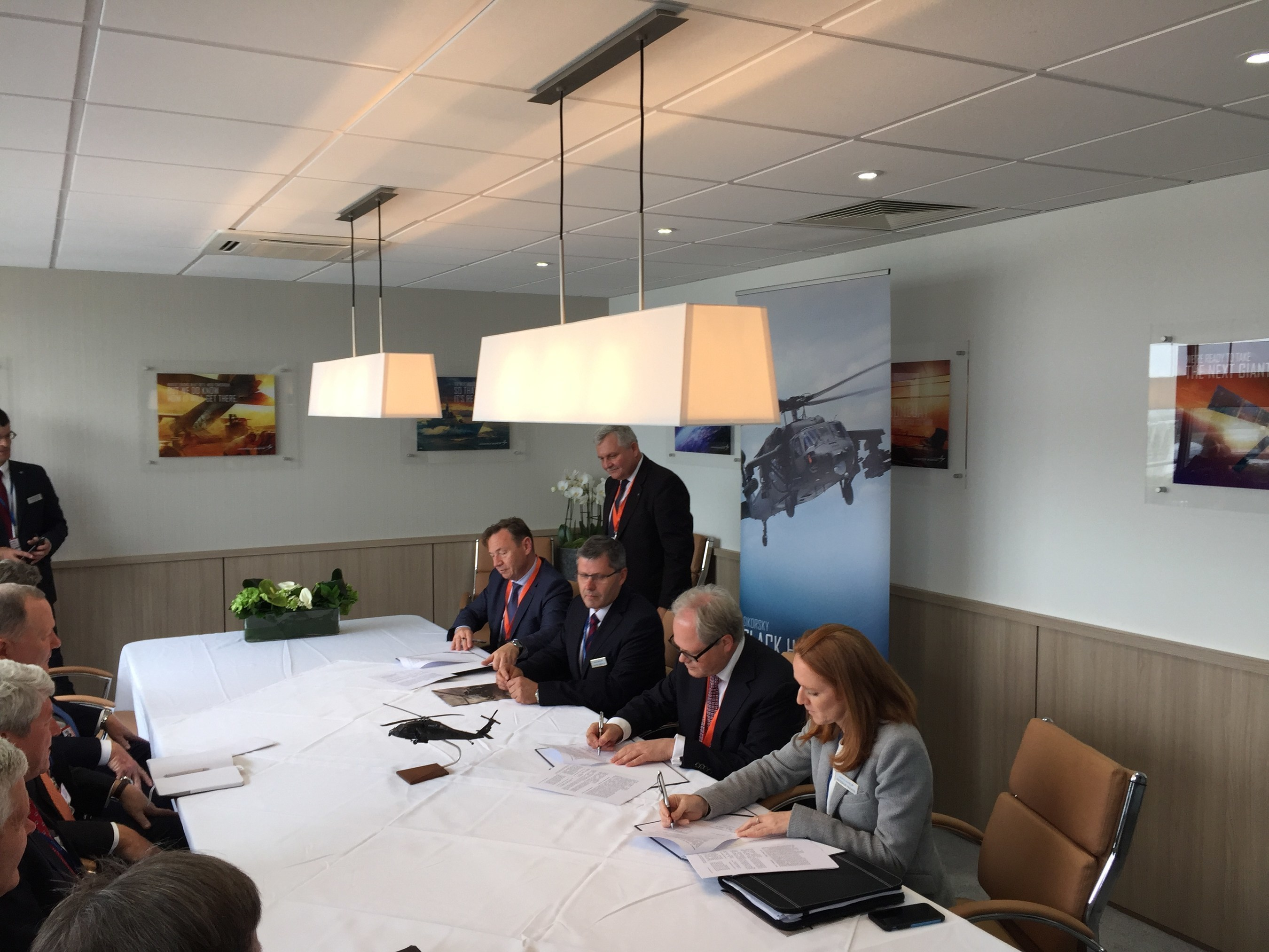 Sikorsky signed a memorandum of understanding with Polska Grupa Zbrojeniowa (PGZ), Poland's industry armaments group during the Farnborough International Airshow. PGZ will have significant involvement in production of the international BLACK HAWK helicopter should the Polish Government order BLACK HAWK aircraft from Sikorsky's PZL Mielec facility. Signing the MOU are Nathalie Previte, vice president, Sikorsky Strategy and Business Development, Arkadiusz Siwko, PGZ president, Janusz Zakrecki, president of PZL Mielec and Radosław Obolewski, Member of the PGZ Management Board.