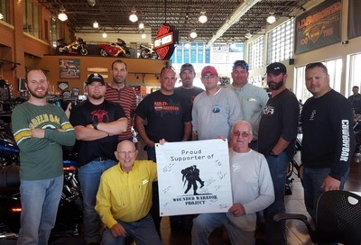 Wounded veterans pose with the Harley-Dealership team after a successful ride in Ohio.