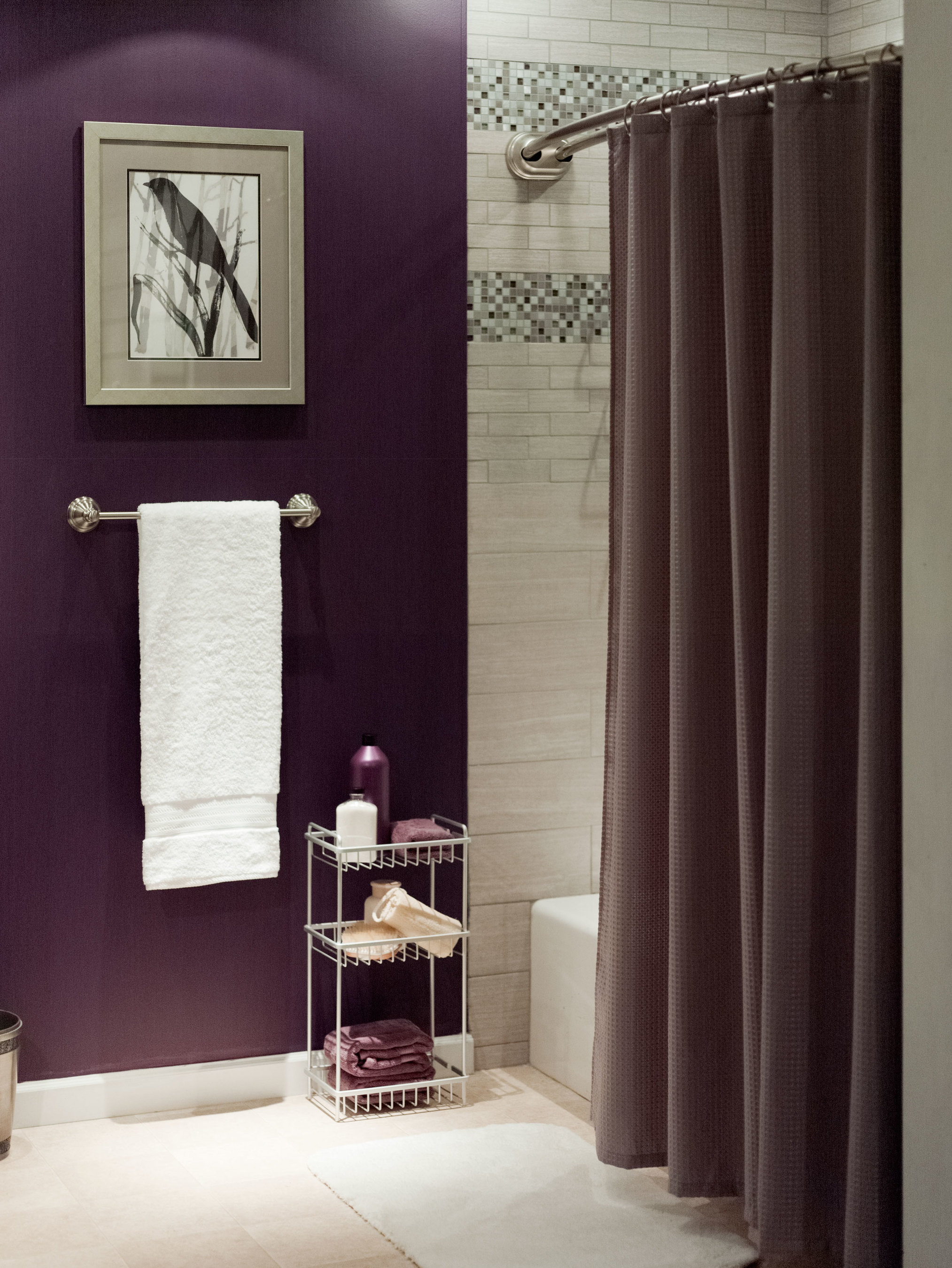 """""""Install a new shower rod, rings and caddy in minutes. Add a distinctive shower curtain and bath towels in fresh colors, and you're ready for spring! It's a great way to affordably transform a bathroom,"""" says Courtney Vagliardo, ZPC design director of fashion bath. (PRNewsFoto/Zenith Products Corp. (ZPC))"""