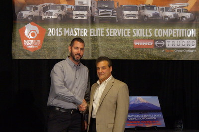 Hino Trucks Service Skills Competition champion, David Taylor of K. Neal (left), receives congratulations from Tom Marchini of Hino Trucks.