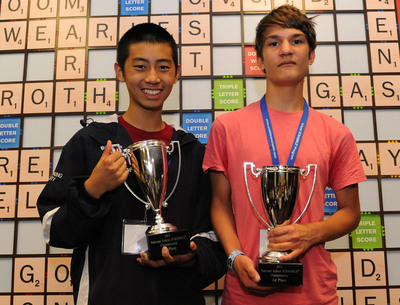 Raymond Gao and Kevin Bowerman from Chapel Hill, NC pose with the winning 2013 National School SCRABBLE Championship trophies in front of the world's largest SCRABBLE board.  (PRNewsFoto/The National SCRABBLE Association, Patricia Hocker)
