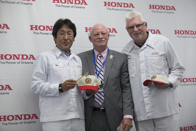 In commemoration of Honda Precision Parts of Georgia's 10th anniversary, Tallapoosa Mayor Pete Bridges (center) provides a key to the city to the president of Honda Precision Parts of Georgia Masahiko Kayama (left) and vice president of Honda Precision Parts of Georgia Mike Jett (right).