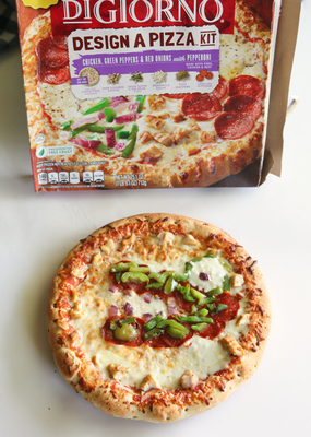 """Christy Denney, """"The Girl Who Ate Everything"""" blogger, uses a new DIGIORNO DESIGN A PIZZA kit to capture a snapshot of an alligator that visits her backyard. DESIGN A PIZZA kits come with individually packaged pizza toppings and a full-size DiGiorno cheese pizza to let you transform pizza night into a deliciously inventive meal."""