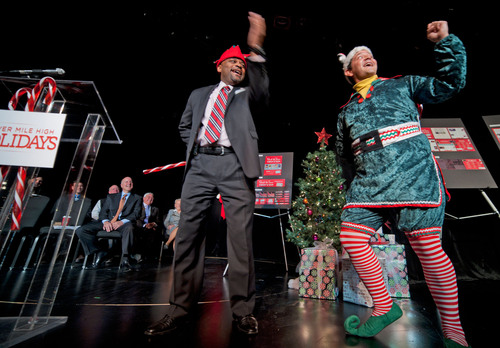 Denver Mayor Michael B. Hancock joined Crumpet the elf and Front Range Tourism leaders to launch the 2013 Mile ...