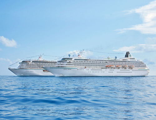 Crystal Serenity and Crystal Symphony at sea together.  (PRNewsFoto/Crystal Cruises)