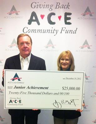 ACE's SVP of Public Affairs Eric Norrington presents JA Dallas' Executive Director Jan Murfield with $25,000.  (PRNewsFoto/ACE Cash Express, Inc.)