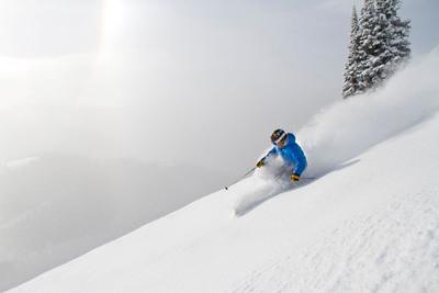 A skier enjoys fresh snow in Sundown Bowl at Vail Mountain.  (PRNewsFoto/Vail Resorts, Vail Mountain)