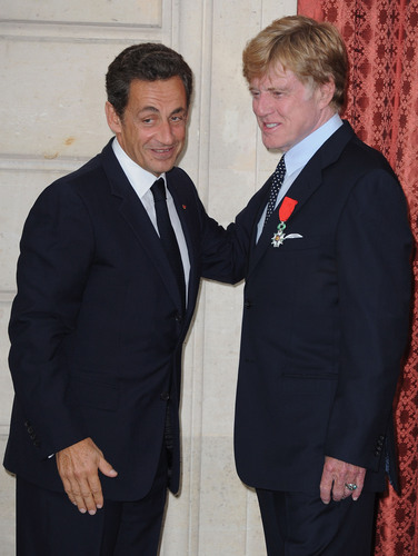 French President Nicolas Sarkozy awards Robert Redford the French Legion d'Honneur at the Palais de ...