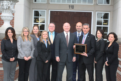 The Delaware County Bank's new Small Business Lending Division flanks Martin Golden, Columbus District Director of the U.S. Small Business Administration (fifth from right). The SBL Division will be headed by John Tonjes (third from right) and Dan Bywater (fourth from right).