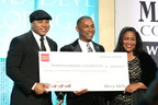 TMCF President & CEO Johnny C. Taylor, Jr. receives check from Wells Fargo