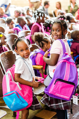 Students at Pulaski Elementary and Middle School receive new backpacks and school supplies from Mike Morse Law Firm on the first day of school.  The firm donated 33,000 backpacks with school supplies to Detroit Public School students.