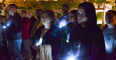 Jean Williams, mother of fallen correctional officer Eric Williams, and Helen Albarati, widow of fallen correctional officer Osvaldo Albarati, gather at a candlelight vigil for correctional workers in Washington, D.C.