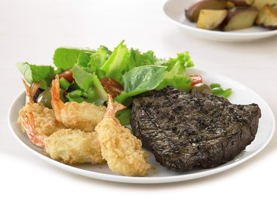 Buffets introduces the new Rancher's Select(R) Sirloin, a hand cut and seasoned favorite, now available every day of the week at all locations starting July 5. Pair it with golden-brown butterfly shrimp for a limited time.  (PRNewsFoto/Buffets, Inc.)